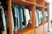 Wardrobe with closed drawer fronts and recessed handles