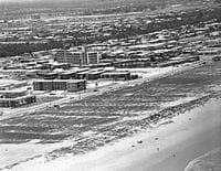 Early development at Broadbeach with Broadbeach Hotel in the background, Queensland, circa 1955. Image thanks to Gold Coast City Council Local Studies Library