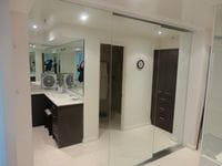 Frameless mirrored doors