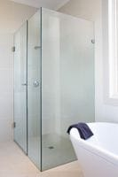 Frameless Shower Screen completes this Luxurious Bathroom. Gold Coasst