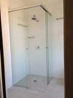 Corner Sliding Frameless Shower Screen. Call Now for a Free Quote. Byron Bay