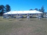 6X18 MARQUEE WITH NO WALLS, UMBRELLAS AND ROUND TABLES