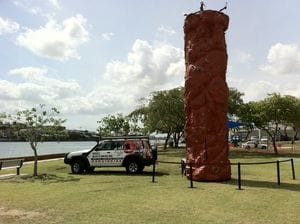 The rock wall beside the river with the 4WD.