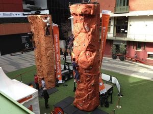 2 Rock climbing walls at an ING community event.