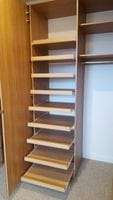 Slide out shoe shelving behind hinged mirror door