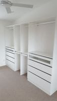 White melamine Walk in robe, glass inserts in drawer fronts, 2 x 14 pair slide out trouser racks