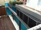 Clifton Hill - Another exterior view of the open bi-parting saw tooth style retractable roof over a pool