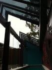 Clifton Hill - An internal view of the open bi-parting saw tooth style retractable roof over a pool