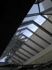 Toorak - An interior view of the closed bi-parting gable style retractable roof over a pool