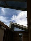 Werribee - An internal view of the open bi-parting saw tooth style retractable roof over an entertaining area