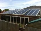 Werribee - An external view of the closed bi-parting saw tooth style retractable roof over an entertaining area
