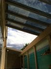 Camberwell 2 - An internal view of the open bi-parting skillion style retractable roof over a pool