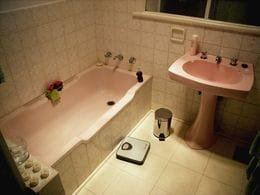 The owners of this bathroom hated the strong pink colour. Instead of replacing all the fittings, Bathroom Werx offered to resurface for a whole new look.